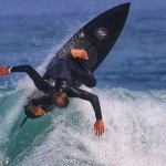 Surfer hitting the lip with SRFACE summer wetsuit