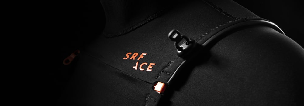 SRFACE wetsuit logo and shoulder tensioner toggle and zip end