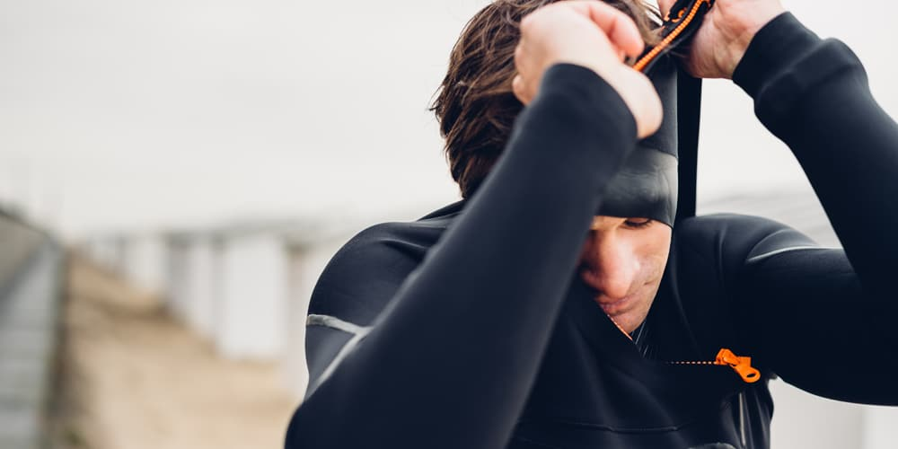 Surfer fitting SRFACE wetsuit